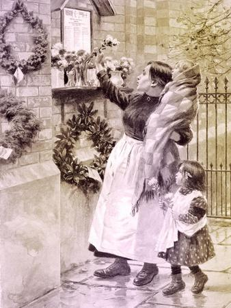 WW1: mother and children place flowers at a war memorial