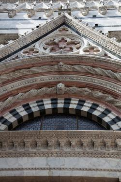 Italy, Siena, Siena Cathedral, Baptistery Facade, Gable and Tympanum by Samuel Magal