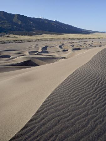 https://imgc.allpostersimages.com/img/posters/sand-dunes-at-dawn-great-sand-dunes-narional-park-and-preserve-colorado-usa_u-L-P7NLC00.jpg?p=0