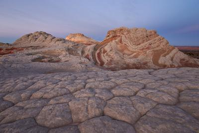 https://imgc.allpostersimages.com/img/posters/sandstone-brain-rock-and-red-and-white-swirls-at-dawn_u-L-PWFDEI0.jpg?artPerspective=n