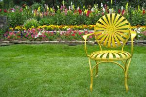 Santa Fe Flower Garden with Vintage Yellow Chair Plastic Sign