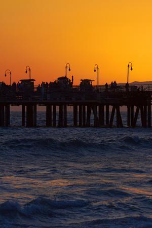 https://imgc.allpostersimages.com/img/posters/santa-monica-pier-at-sunset-santa-monica-los-angeles-california_u-L-PU3FJ80.jpg?p=0