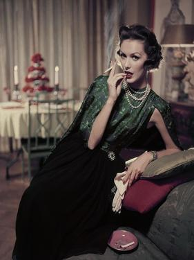 Glamour - December 1956 - Woman Smoking at Home by Sante Forlano