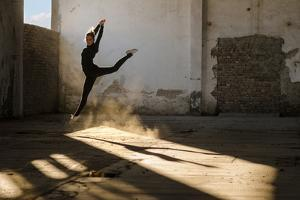 Beautiful Young Ballerina Dancing in Abandoned Building. by Sasa Prudkov