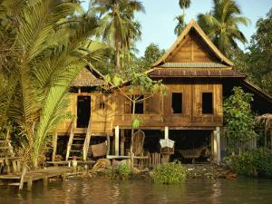 Traditional Thai House on Stilts Above the River in Bangkok, Thailand, Southeast Asia by Sassoon Sybil