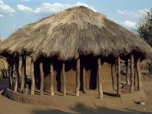 Typical House in Village, Zambia, Africa by Sassoon Sybil