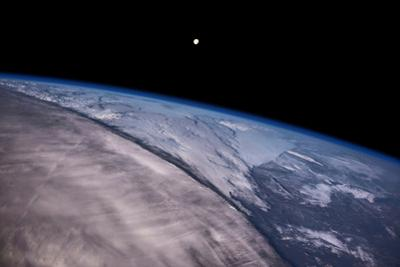 Satellite view of Earth with moon glowing over Saskatchewan, Canada