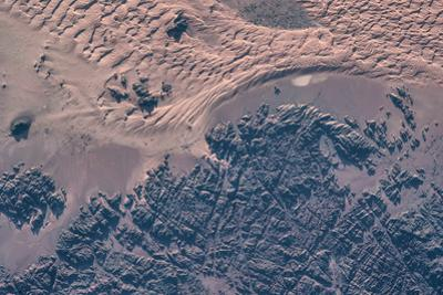 Satellite view of wet sand on riverbed, Ha'il Province, Saudi Arabia