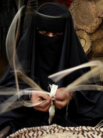 Saudi Woman Works to Demonstrate Her Craft as She Makes a Cane Box at a Fair in Riyadh