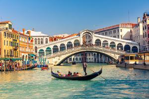 Gondola near Rialto Bridge in Venice, Italy by sborisov