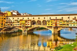 Ponte Vecchio over Arno River in Florence, Italy by sborisov