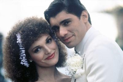 https://imgc.allpostersimages.com/img/posters/scarface-1983-directed-by-brian-by-palma-elizabeth-mastrantonio-and-steven-bauer-photo_u-L-Q1C20R30.jpg?artPerspective=n