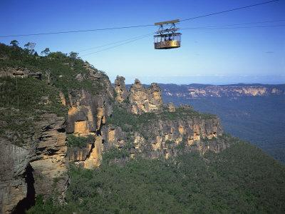 https://imgc.allpostersimages.com/img/posters/scenic-skyway-above-the-three-sisters-at-katoomba-blue-mountains-new-south-wales-australia_u-L-P7QUMG0.jpg?artPerspective=n