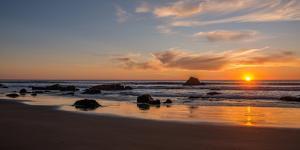 Scenic view of beach at sunset, San Simeon, San Luis Obispo County, California, USA