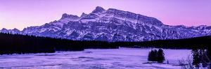 Scenic view of frozen Two Jack Lake at dawn, Mount Rundle, Banff National Park, Alberta, Canada