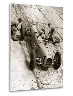 Changing tires at the Grand Prix on Nuerburgring, 1934 by Scherl