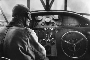 Pilot in a Cockpit of a Passenger Airplane by Fokker, 1926 by Scherl S?ddeutsche Zeitung Photo