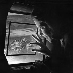 A Stewardess Looking Through an Airplane Window, 1938 by Scherl Süddeutsche Zeitung Photo
