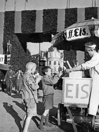 Ice Cream Salesman at One of the Gates to the Oktoberfest, Ca. 1935 by Scherl Süddeutsche Zeitung Photo