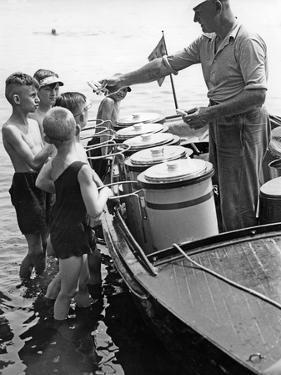 Iceman Selling Ice-Cream from Aboard a Boat on the Lange See Near Berlin, 1930s by Scherl Süddeutsche Zeitung Photo