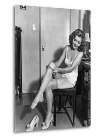 Woman Putting on Stockings, 1933