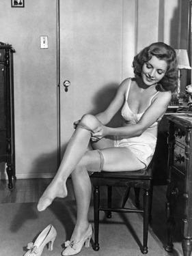 Woman Putting on Stockings, 1933 by Scherl Süddeutsche Zeitung Photo
