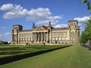 German Flag Flies in Front of the Reichstag in Berlin, Germany, Europe by Scholey Peter