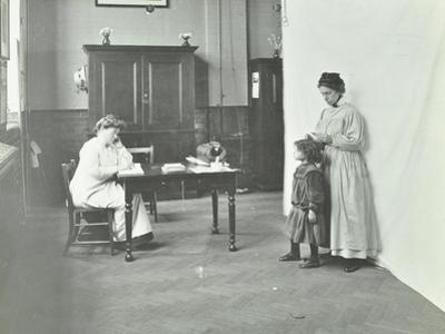 School Nurse Examining Girls Hair for Head Lice, Chaucer School, London, 1911