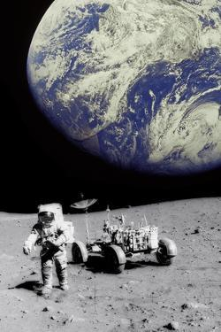 Astronaut on Moon with Earth by Science Photo Library