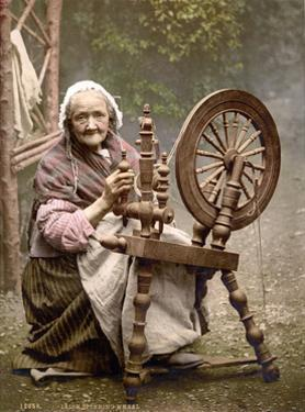 Irish Spinner and Spinning Wheel, 1890s by Science Source