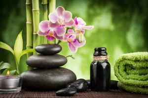 Spa Concept Zen Basalt Stones ,Orchid and Candle by scorpp