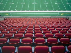 Empty seats in stadium by Scott Barrow