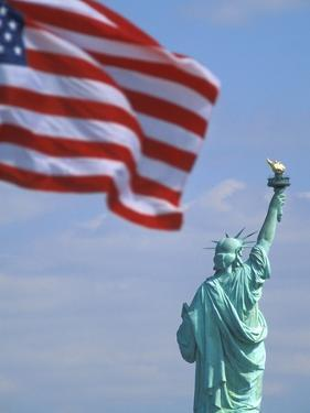 Statue of Liberty and American Flag by Scott Barrow