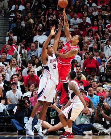 Chicago Bulls v Atlanta Hawks - Game Four,  ATLANTA - MAY 8: Derrick Rose and Jason Collins by Scott Cunningham