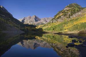 The Scenic Maroon Lake at Dawn in the Maroon Bells-Snowmass Wilderness by Scott S. Warren