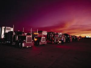 Vivid Sunset over Trucks Parked in a Truck Stop Near Sayre, Oklahoma by Scott Sroka