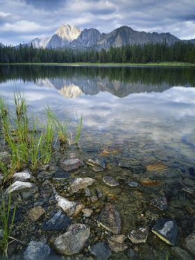 Stones Along Shore of Frog Lake with Mountain Peaks in Back, Sawtooth National Recreation Area, USA by Scott T. Smith