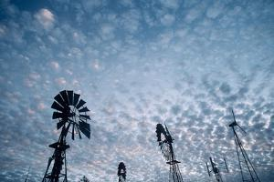 Windmills and clouds at dusk, Las Cruces, New Mexico, USA by Scott T. Smith