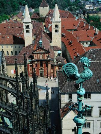 https://imgc.allpostersimages.com/img/posters/sculpted-cock-standing-high-above-entrance-prague-czech-republic_u-L-P4FR4O0.jpg?artPerspective=n
