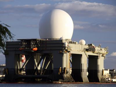 https://imgc.allpostersimages.com/img/posters/sea-based-x-band-radar-dome-modeled-by-the-setting-sun-at-pearl-harbor-naval-shipyard_u-L-PJ39TH0.jpg?artPerspective=n