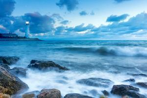 Lighthouse by Sea Wave