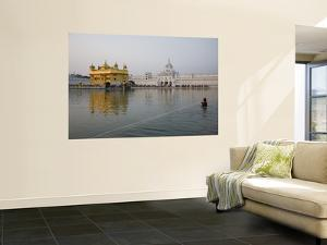 Harmandir Sahib (Golden Temple), Reflecting in the Waters of the Amrit Sarovar by Sean Caffrey