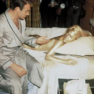 Sean Connery and Shirley Eaton on set of film Goldfinger, 1964 (photo)