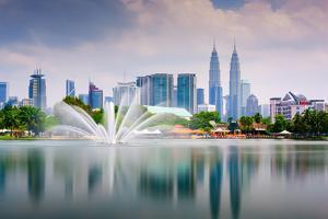Kuala Lumpur, Malaysia Skyline at Titiwangsa Park by Sean Pavone