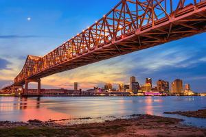 New Orleans, Louisiana, USA at Crescent City Connection Bridge over the Mississippi River. by Sean Pavone