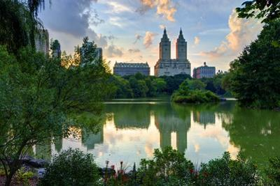 Upper West Side Skyline from Central Park Lake in New York City. by Sean Pavone