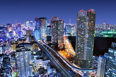 Dense Buildings In Minato-Ku, Tokyo Japan With Tokyo Sky Tree Visible On The Horizon