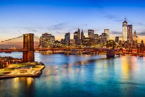 New York City, USA Skyline over East River and Brooklyn Bridge. by SeanPavonePhoto