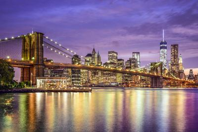 New York, New York, USA City Skyline with the Brooklyn Bridge and Manhattan Financial District Over