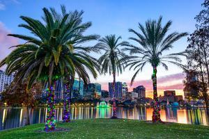 Orlando, Florida, USA Downtown Skyline at Eola Lake. by SeanPavonePhoto